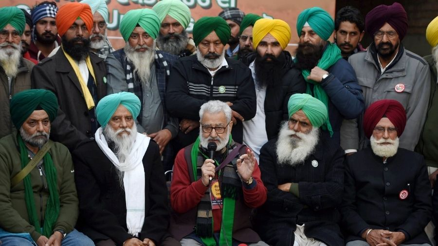 Farmer leaders address a press conference at the Singhu border, in Delhi, on Friday.