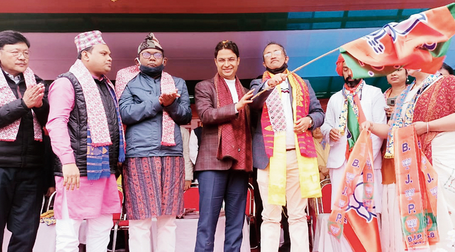 Darjeeling MP Raju Bista welcomes a Morcha leader to the BJP at the event on Siliguri outskirts on Tuesday.