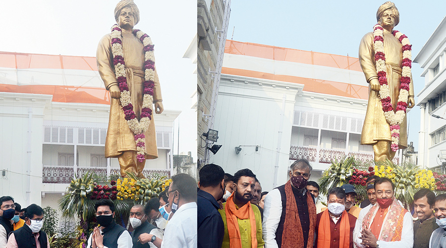 Abhishek Banerjee (left) and BJP leaders near the statue of Swami Vivekananda at his ancestral house in Calcutta on Tuesday.