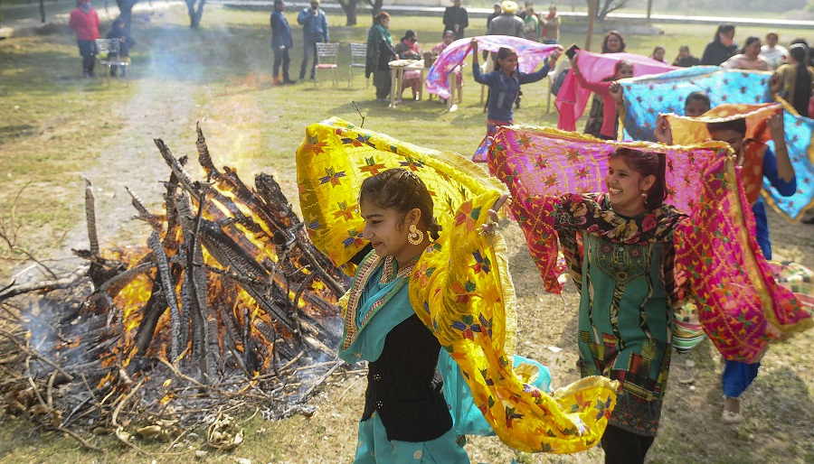 Teachers and students celebrate Lohri' festival at GCG College in Patiala on Wednesday.