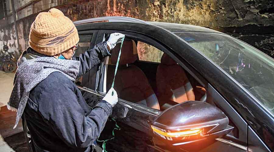 Police examine Rupesh's car on Wednesday