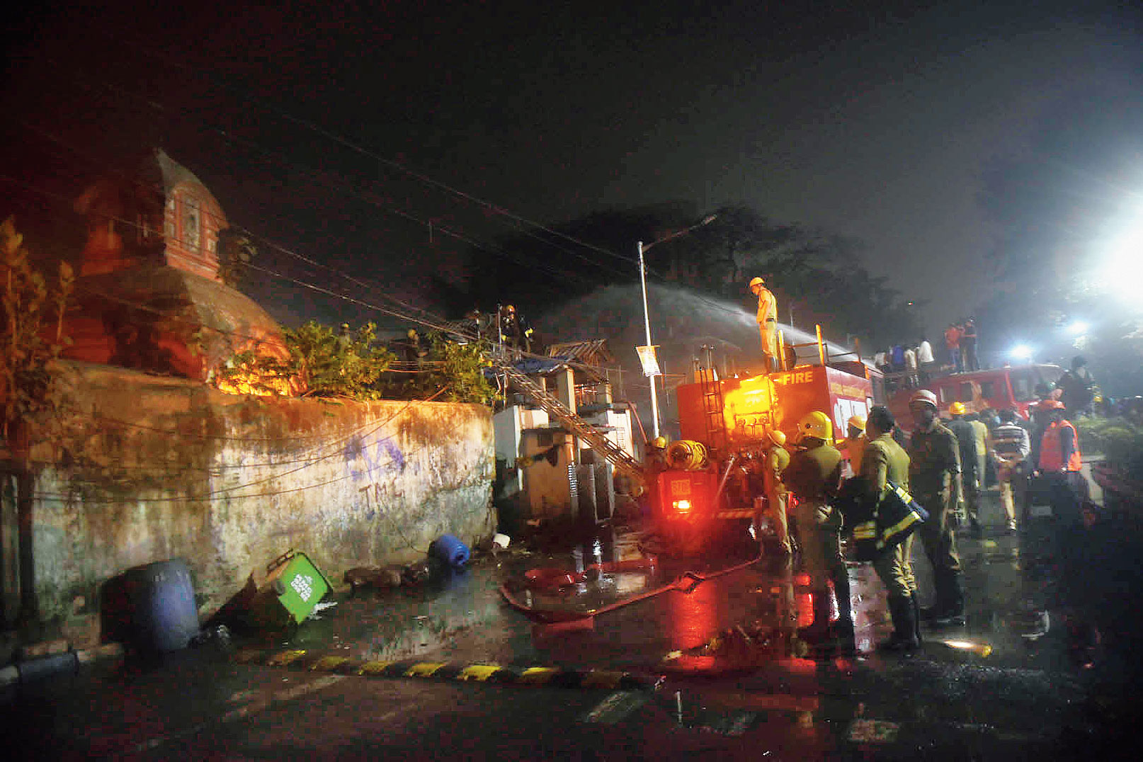 Fire-fighters douse the blaze on Wednesday evening.