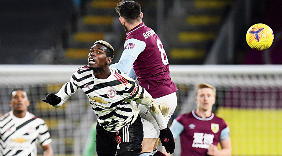 Paul Pogba of Manchester United and Josh Brownhill of Burnley in an aerial tussle at Turf Moor, Burnley, on Tuesday.