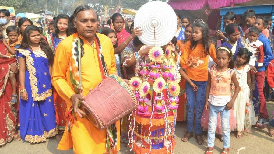 A man beats a traditional drum as people celebrate harvest festival 'Tusu' on the day of Makar Sakranti at Mohalbani Ghat in Dhanbad on Thursday.