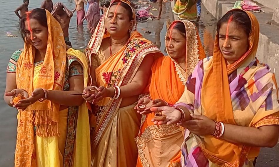 Women pray to the Sun God on the banks of river Damodar at Mohalbani Ghat in Dhanbad on Thursday.