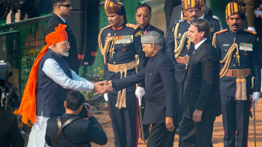 Prime Minister Narendra Modi receives President Ram Nath Kovind and chief guest Brazilian President Jair Messias Bolsonaro on their arrival for the 71st Republic Day Parade at Rajpath in New Delhi, Sunday, January 26, 2020.