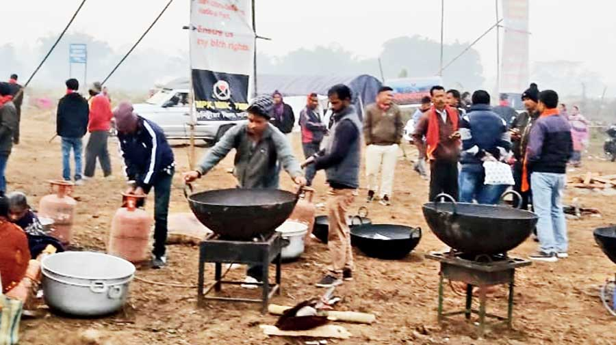 Camp inmates prepare the Bhogali feast on Thursday