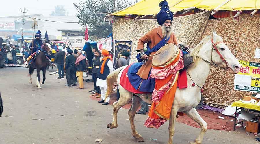 Mounted Nihangs at the Singhu border near New Delhi on Friday