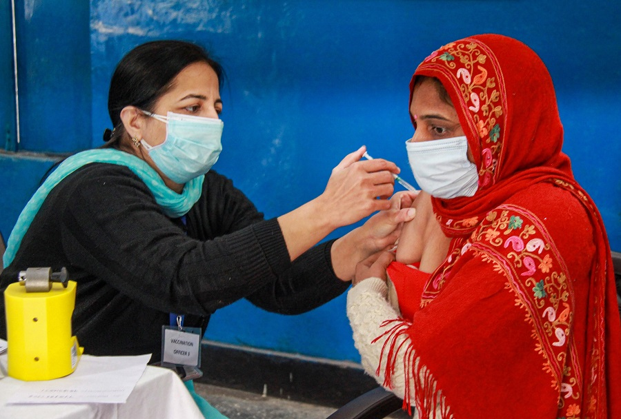 A medic administers the first dose of COVID-19 vaccine to a frontline worker, at Government Girls School in Gurugram.
