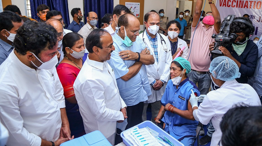 A medic administers the first dose of Covishield vaccine to a frontline worker in the presence of Union Minister of State for Home Affairs G Kishan Reddy and other ministers, at Gandhi Hospital in Hyderabad.