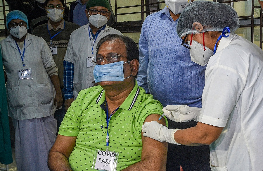 A medic administers the COVID-19 vaccine to a frontline worker, at Calcutta Medical College.