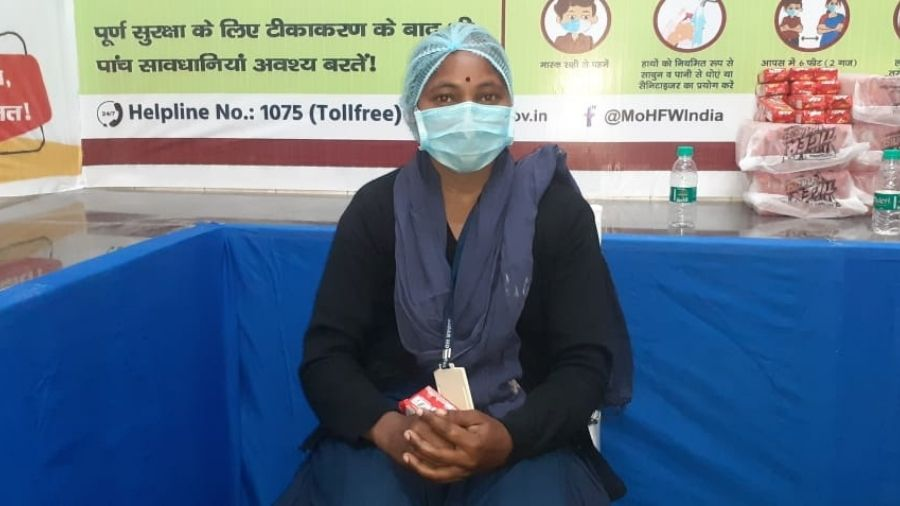 Sadar hospital cleanliness worker Mariam Guriya awaits her turn for the vaccine in Ranchi on Saturday.