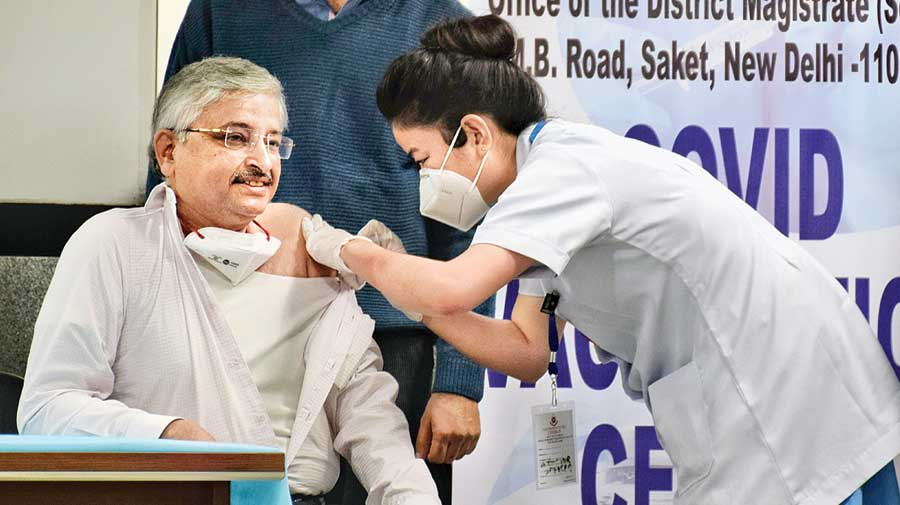 AIIMS director Dr Randeep Guleria receives the  vaccine in New Delhi  on Saturday.
