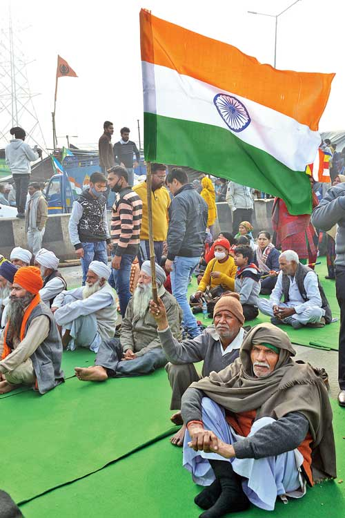 The protesting farmers at the Ghazipur border on Sunday.