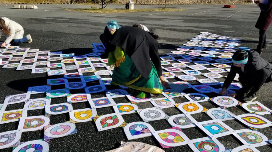 In front of the US Capitol on Thursday, thousands of kolam tiles being made to welcome Joe Biden and Kamala Harris later this month.