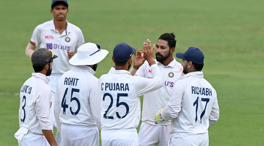 Mohammed Siraj celebrates with teammates after the dismissal of Mitchell Starc during fourth day of the 4th Test Match, at The Gabba on Monday.