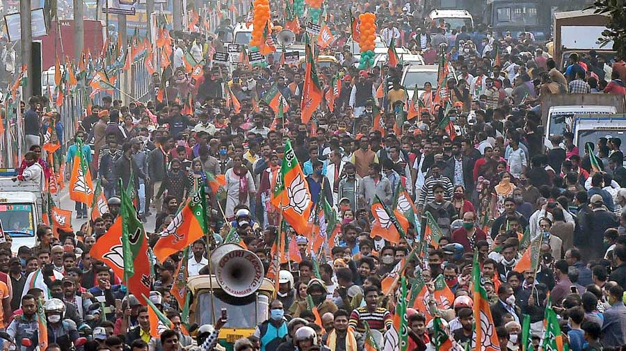 BJP supporters take part in the rally at Rashbehari crossing on Monday.