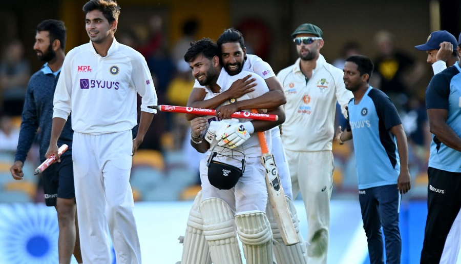 Rishabh Pant celebrates victory with his teammates after day five of the 4th Test, in Brisbane on Tuesday.