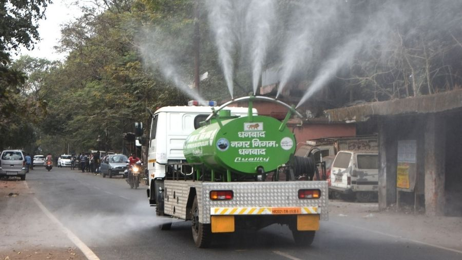 A truck mounted water sprinkler at work in Dhanbad on Tuesday.
