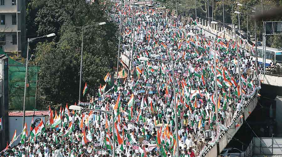 Congress party workers take out a rally in Bangalore on Wednesday