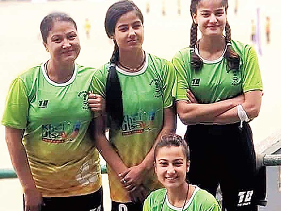 Chandrakala Sharma (left) and her three daughters who shot to fame for playing football