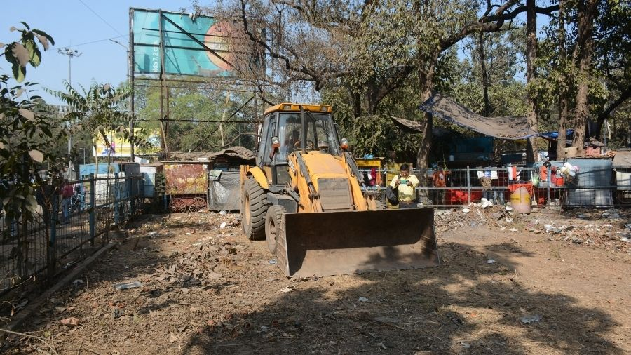 An earth-mover at work to remove encroachments from an area at Sakchi in Jamshedpur on Thursday to make way for an authorised  vending zone.