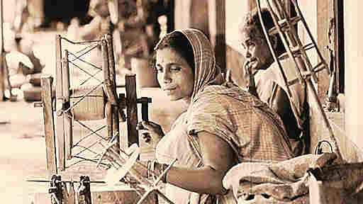 Weavers weaving Dhaniakhali Sarees, a small scale industry hypothecated by State Bank of India.