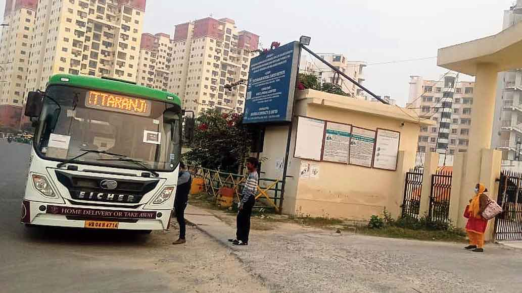An electric bus picks up passengers from the gate of Chittaranjan National Cancer Institute