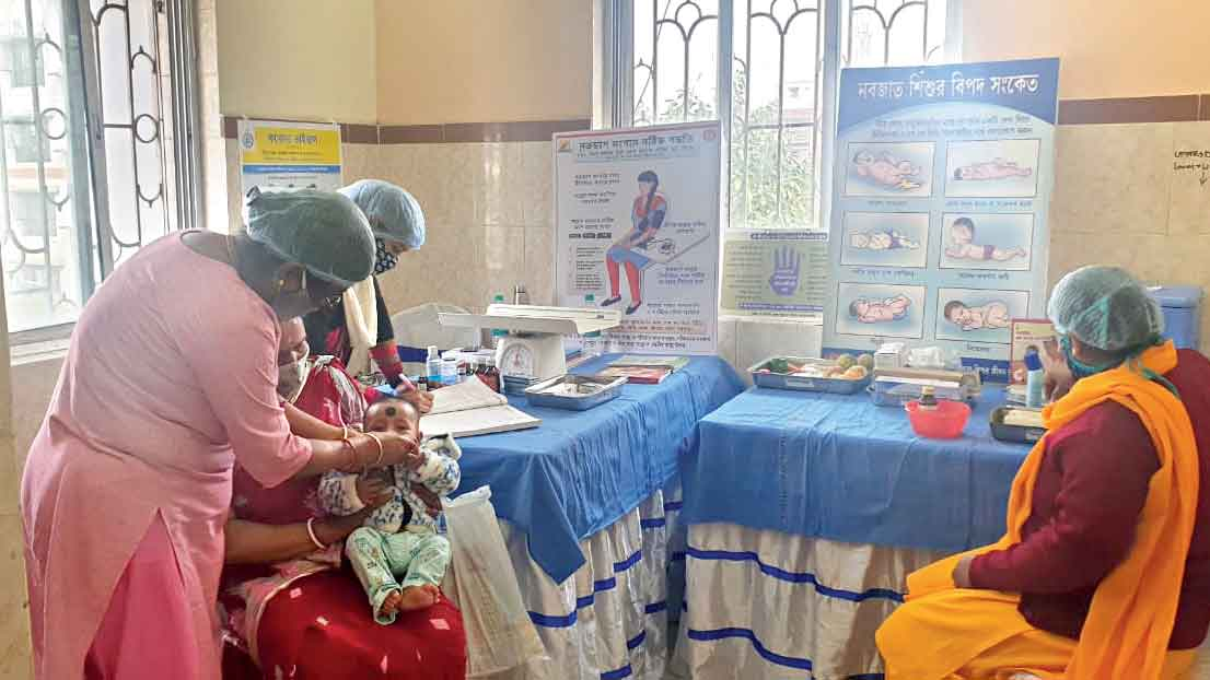 A baby being immunised at CB market community hall