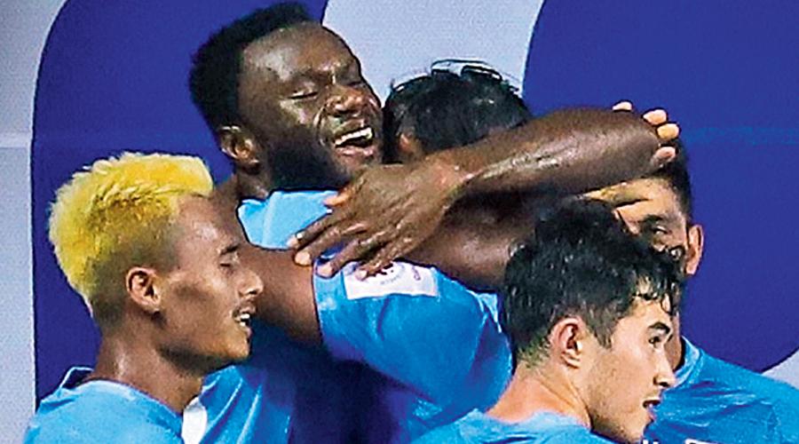 Mumbai City players celebrate Mourtada Fall's goal.