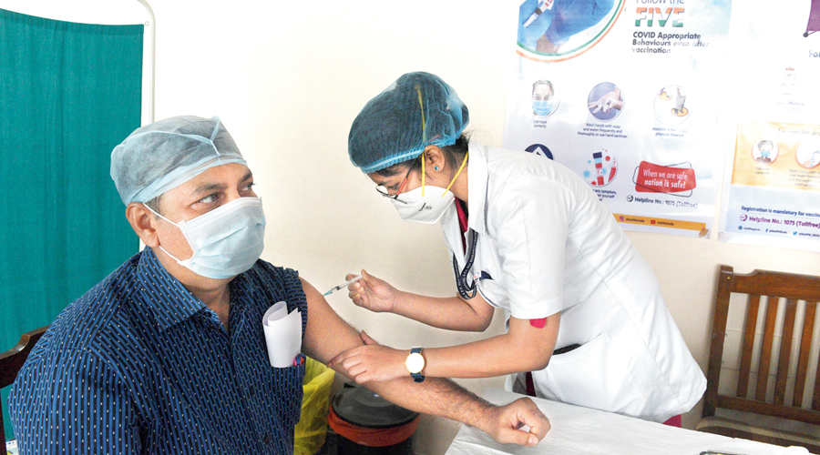 A Covid vaccine dose being administered at a site in Chetla.