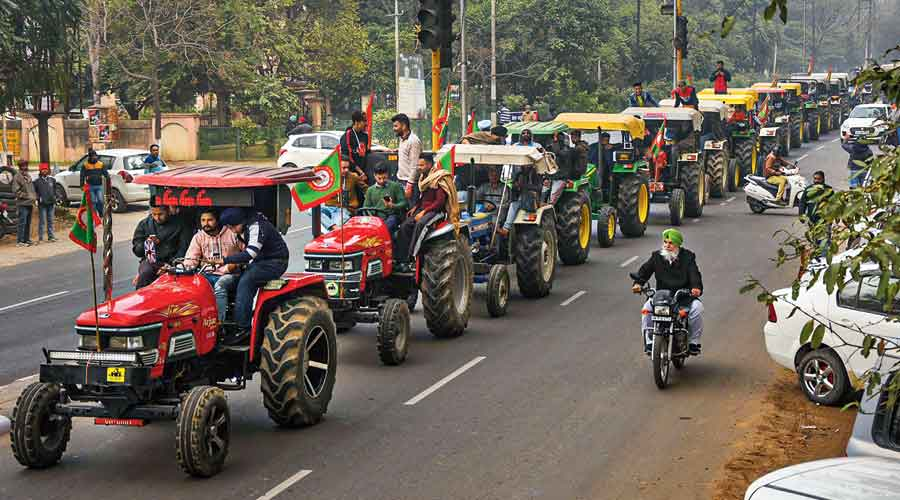 Farmers take out a tractor march in Patiala on Friday as part of the preparations for their planned parade on Republic Day in New Delhi