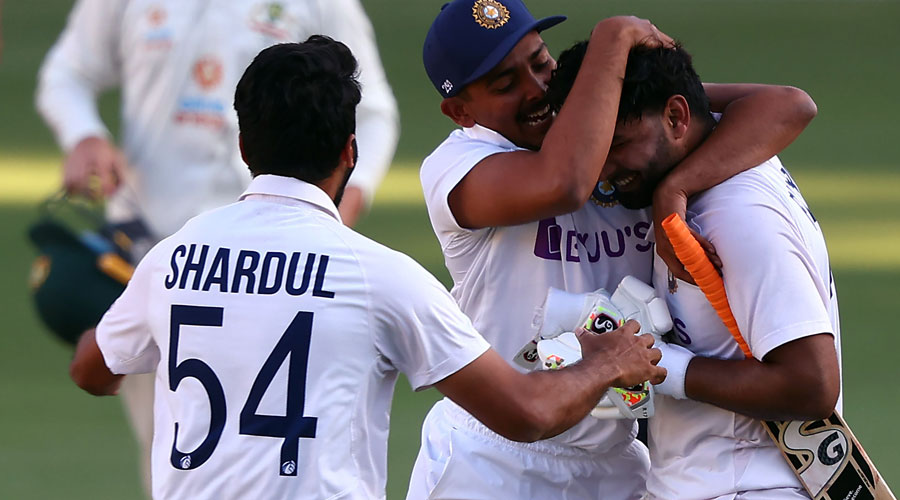 Indian players celebrate after defeating Australia at the Gabba.