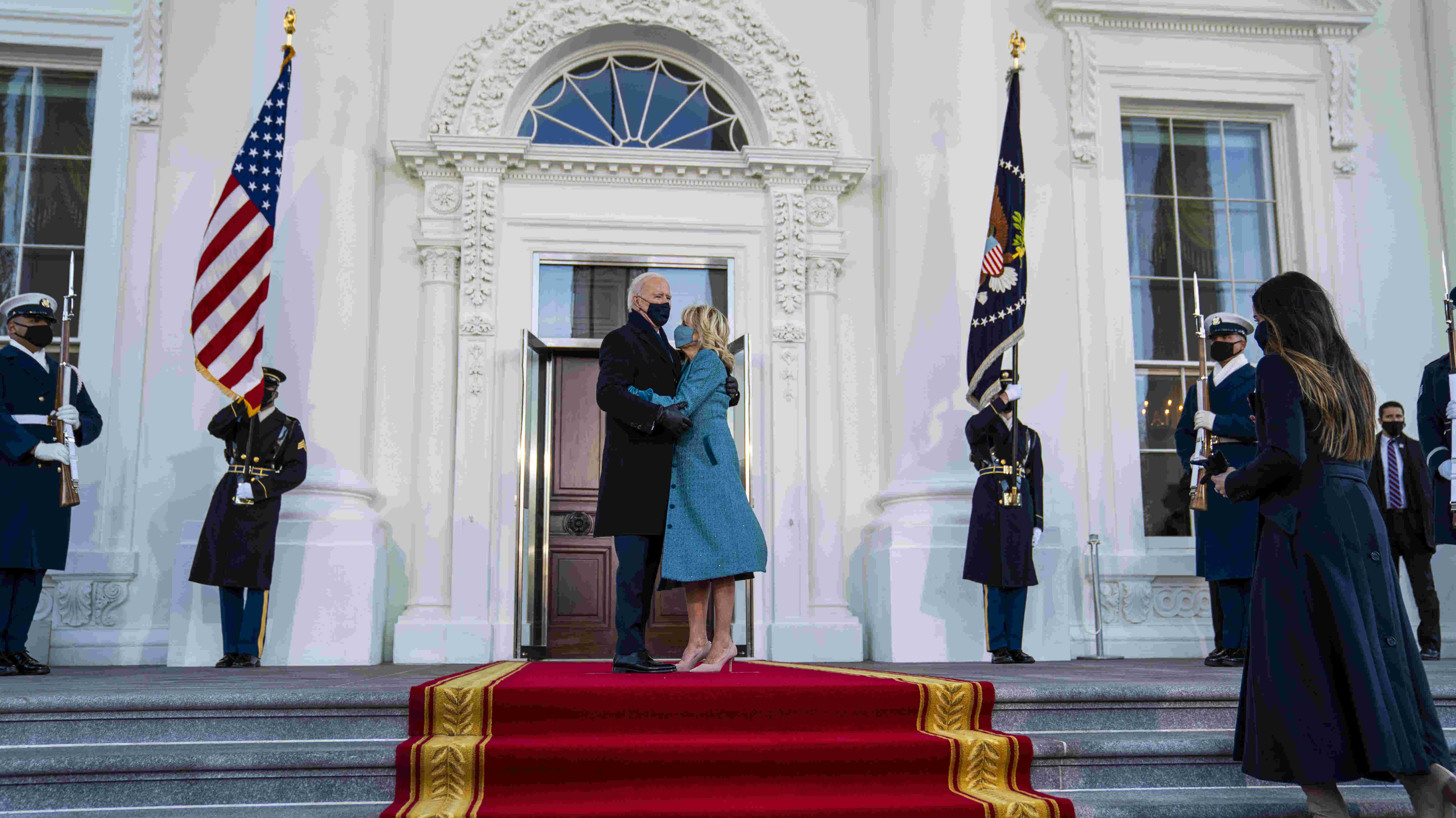 President Joe Biden and first lady Jill Biden embrace before entering the White House on Inauguration Day in Washington, Jan. 20, 2021.