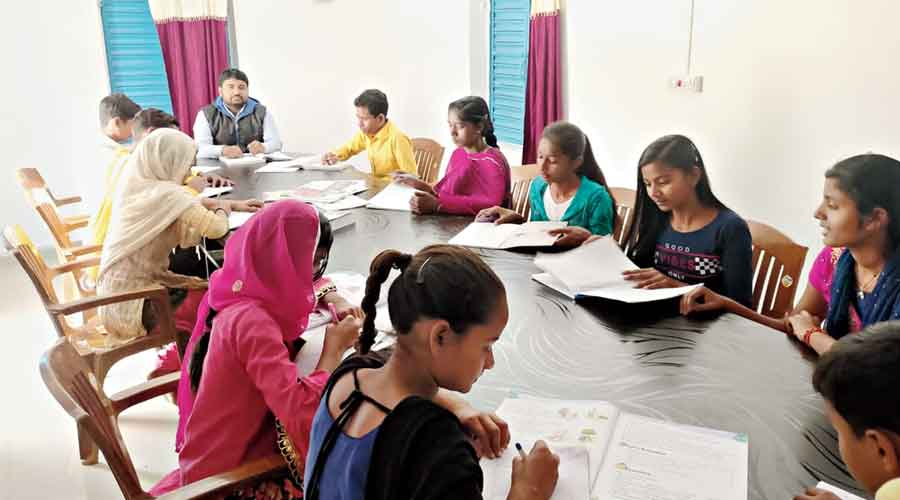 Youths and students at the rural libraries opened  by the Jamtara district administration