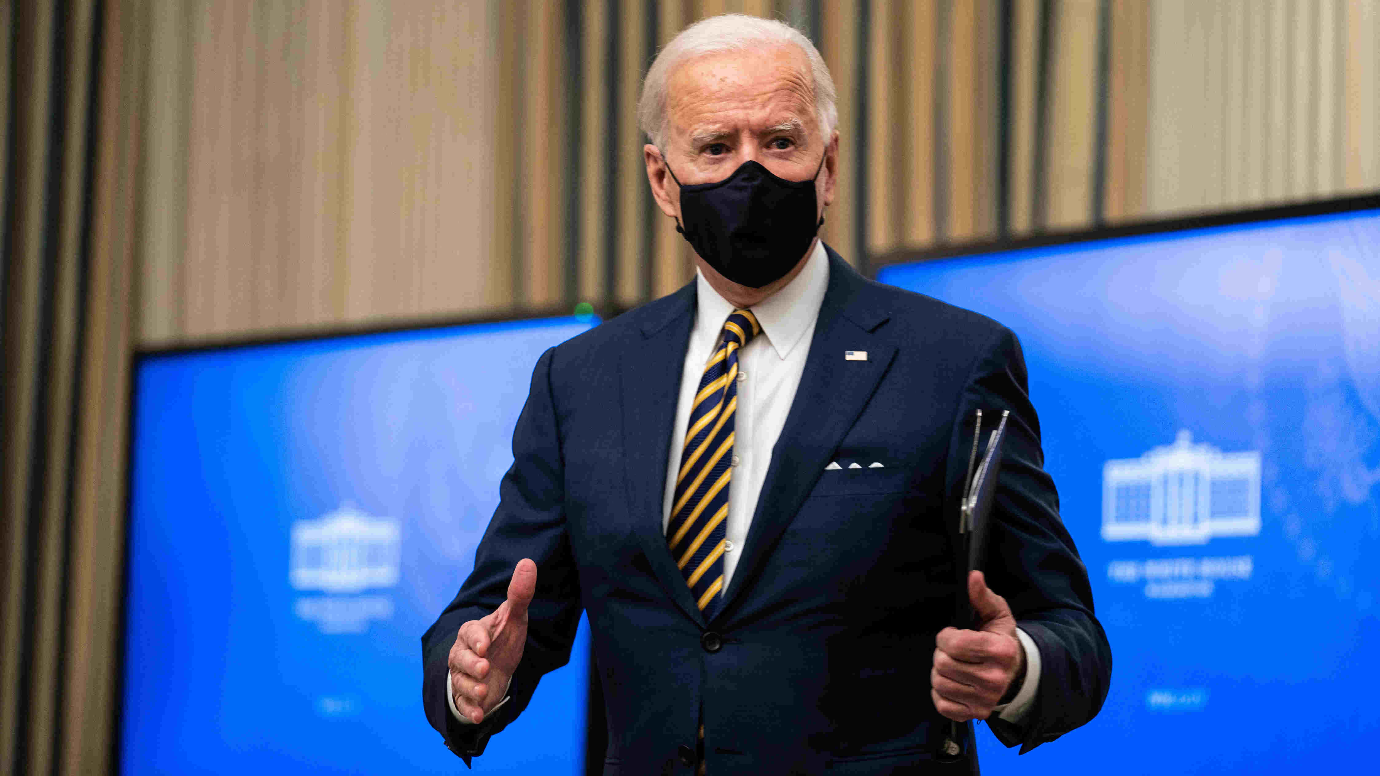 President Joe Biden responds to a reporter question after signing executive orders regarding his administration's response to the economic crisis, at the White House in Washington on Friday, Jan. 22, 2021.