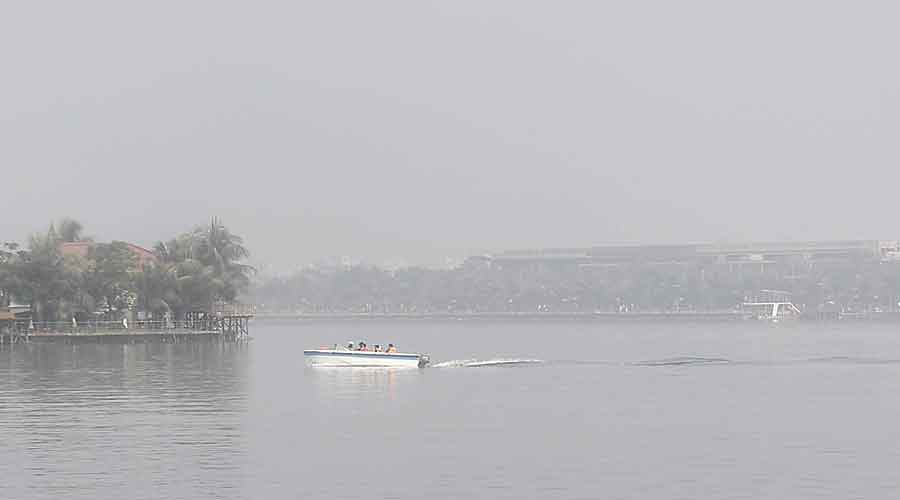 A veil of fog engulfs a water body at Eco Park, in New Town, on Sunday morning.