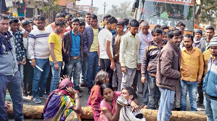 Relatives of the girl child wail at the site of the mishap in Latehar