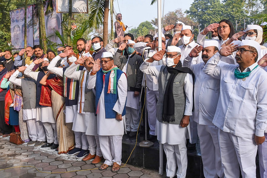 Senior Congress leader Digvijaya Singh hoists the National Flag on the occasion of Republic Day celebration at PCC office in Bhopal on Tuesday.