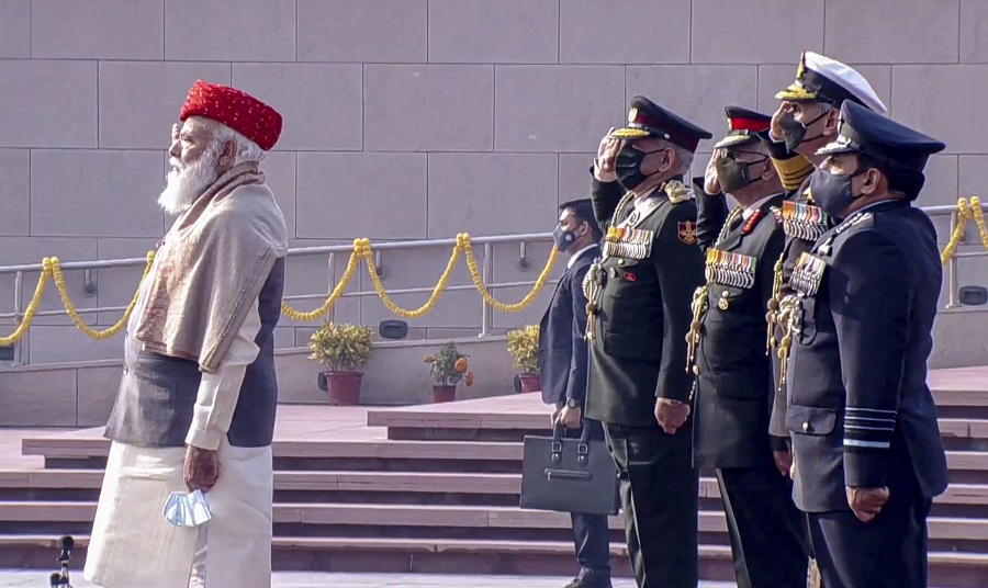 Prime Minister Narendra Modi pays homage to the martyrs at the National War Memorial on the occasion of Republic Day, in New Delhi on Tuesday.