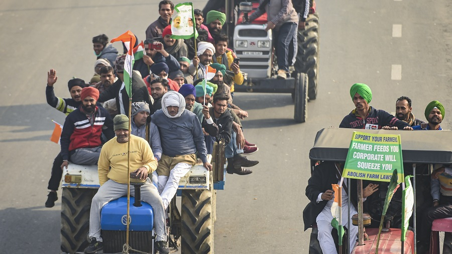 Farmers on their tractors move towards Akshardham after breaking the police barricades during the tractor rally on Republic Day in New Delhi on Tuesday.