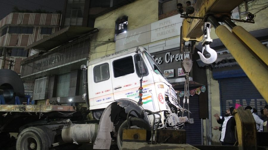 A crane is pressed in service for removing the loaded trailer from near the eatery on Kalimati Road in Sakchi, on Tuesday.