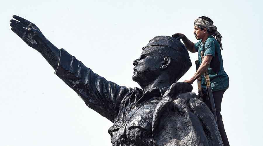 A statue of Netaji Subhas Chandra Bose in Calcutta being painted before his 125th birth anniversary