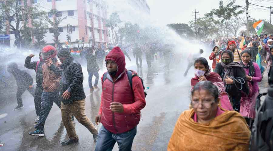 Police fire water cannons to disperse the protesting teachers in Agartala on Wednesday