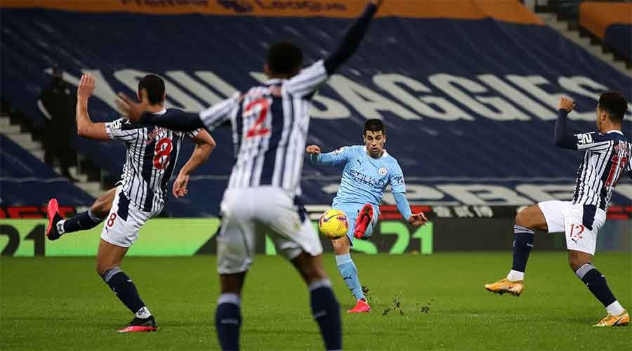 Joao Cancelo of Manchester City scores against West Brom on Tuesday.