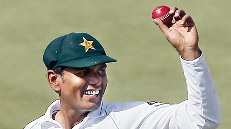 Pakistan's Nauman Ali celebrates his five-wicket haul on Friday.