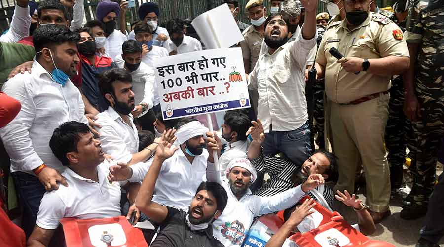 Delhi Pradesh Youth Congress members stage a protest against LPG and fuel price hike outside Shastri Bhawan in New Delhi on Saturday, July 3, 2021.
