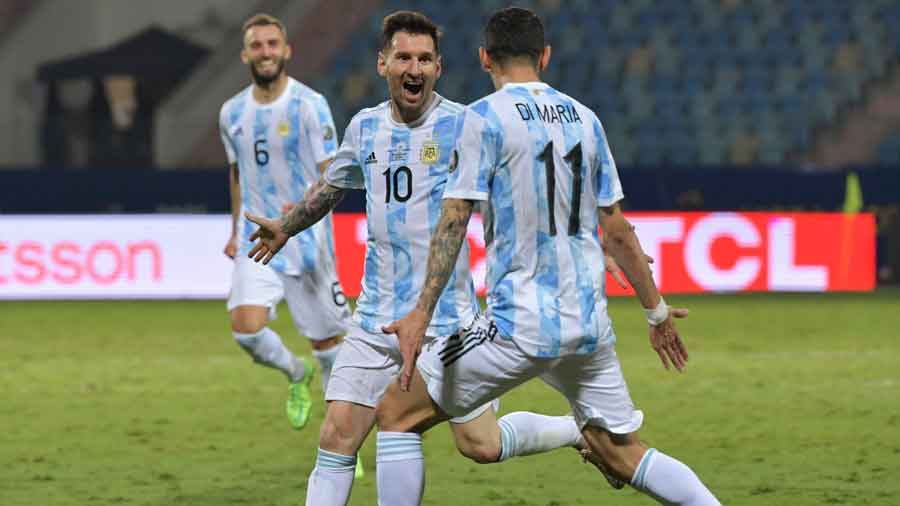 Lionel Messi celebrates with Angel Di Maria after scoring Argentina's third goal on Saturday.