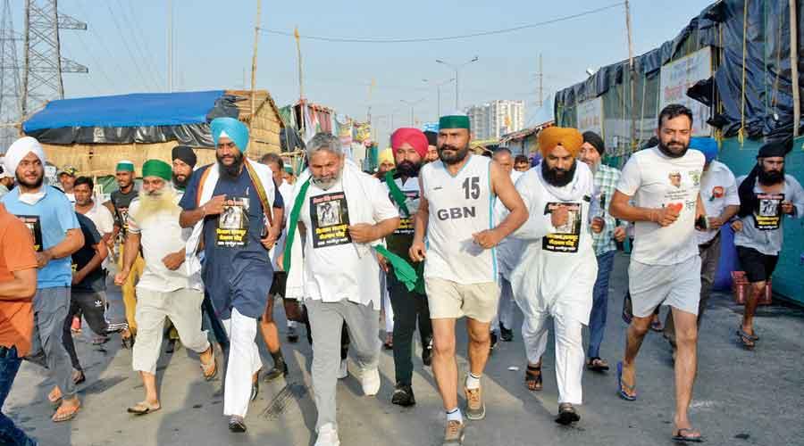 Bharatiya Kisan Union spokesperson Rakesh Tikait and other farmers participate in a marathon organised by Kisan Ekta Morcha in the memory of Milkha Singh at Delhi's Ghazipur border on Sunday