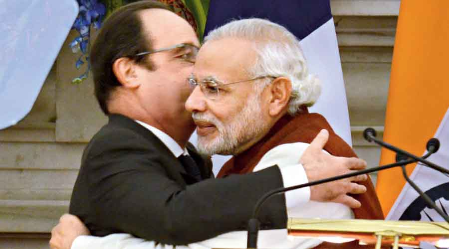 Prime Minister Narendra Modi and then French President Francois Hollande are locked in a hug in Hyderabad House, New Delhi, on January 25, 2016, after it was announced that the two countries had inked a memorandum of understanding on the Rafale fighter aircraft. In September that year, the inter-governmental agreement on 36 Rafale aircraft was signed